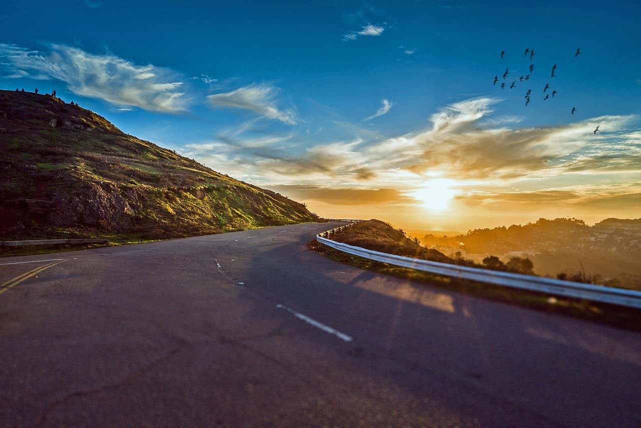 winding road, sunset, mountains